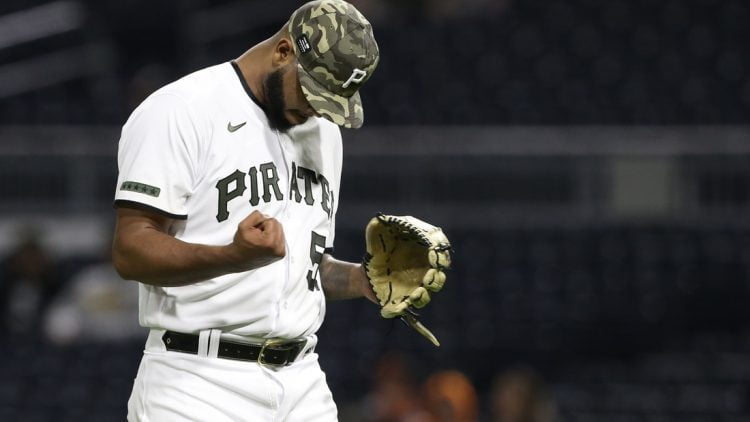 May 14, 2021; Pittsburgh, Pennsylvania, USA; Pittsburgh Pirates relief pitcher Luis Oviedo (57) reacts after pitching the eleventh inning against the San Francisco Giants at PNC Park. The Pirates won 3-2 in eleven innings. Mandatory Credit: Charles LeClaire-USA TODAY Sports