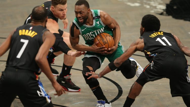 May 25, 2021; Brooklyn, New York, USA; Boston Celtics point guard Kemba Walker (8) drives to the basket against Brooklyn Nets power forward Kevin Durant (7) and power forward Blake Griffin (2) and point guard Kyrie Irving (11) during the first quarter of game two of the first round of the 2021 NBA Playoffs at Barclays Center. Mandatory Credit: Brad Penner-USA TODAY Sports