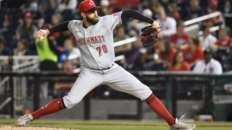 May 25, 2021; Washington, District of Columbia, USA; Cincinnati Reds relief pitcher Tejay Antone (70) throws to the Washington Nationals during the seventh inning at Nationals Park. Mandatory Credit: Brad Mills-USA TODAY Sports