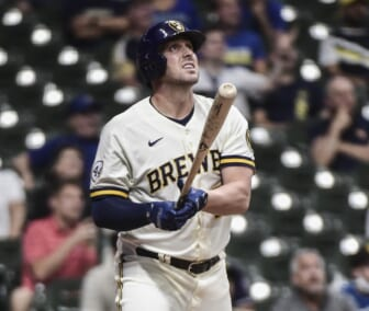 May 25, 2021; Milwaukee, Wisconsin, USA; Milwaukee Brewers third baseman Travis Shaw (21) watches his solo home run during the seventh inning against the San Diego Padres at American Family Field. Mandatory Credit: Benny Sieu-USA TODAY Sports