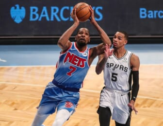 May 12, 2021; Brooklyn, New York, USA; Brooklyn Nets forward Kevin Durant (7) and San Antonio Spurs guard Dejounte Murray (5) at Barclays Center. Mandatory Credit: Wendell Cruz-USA TODAY Sports