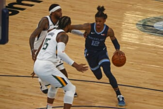 May 31, 2021; Memphis, Tennessee, USA; Memphis Grizzlies guard Ja Morant (12) drives to the basket during the first quarter during game four in the first round of the 2021 NBA Playoffs against the Utah Jazz at FedExForum. Mandatory Credit: Petre Thomas-USA TODAY Sports