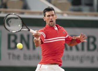 Jun 1, 2021; Paris, France; Novak Djokovic (SRB) in action during his match against Tennys Sandgren (USA) on day three of the French Open at Roland Garros Stadium. Mandatory Credit: Susan Mullane-USA TODAY Sports