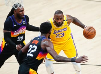 Jun 1, 2021; Phoenix, Arizona, USA; Los Angeles Lakers forward LeBron James (23) drives to the basket against the Phoenix Suns in the first half during game five in the first round of the 2021 NBA Playoffs at Phoenix Suns Arena. Mandatory Credit: Mark J. Rebilas-USA TODAY Sports