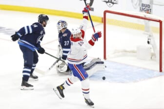 Jun 2, 2021; Winnipeg, Manitoba, CAN; Montreal Canadiens center Jesperi Kotkaniemi (15) scores a first period goal against Winnipeg Jets goaltender Connor Hellebuyck (37) in game one of the second round of the 2021 Stanley Cup Playoffs at Bell MTS Place. Mandatory Credit: James Carey Lauder-USA TODAY Sports