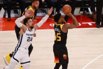 Jun 2, 2021; Salt Lake City, Utah, USA; Utah Jazz guard Donovan Mitchell (45) gets away from Memphis Grizzlies forward Dillon Brooks (24) and shoots the ball during the first quarter in game five of the first round of the 2021 NBA Playoffs at Vivint Arena. Mandatory Credit: Chris Nicoll-USA TODAY Sports