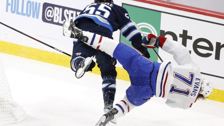 Jun 2, 2021; Winnipeg, Manitoba, CAN; Winnipeg Jets center Mark Scheifele (55) hits Montreal Canadiens center Jake Evans (71) in the third period in game one of the second round of the 2021 Stanley Cup Playoffs at Bell MTS Place. Mandatory Credit: James Carey Lauder-USA TODAY Sports