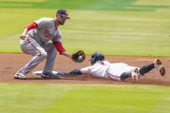 Jun 3, 2021; Cumberland, Georgia, USA; Atlanta Braves second baseman Ozzie Albies (1) steals second base ahead of a tag by Washington Nationals shortstop Jordy Mercer (27) during the first inning at Truist Park. Mandatory Credit: Dale Zanine-USA TODAY Sports