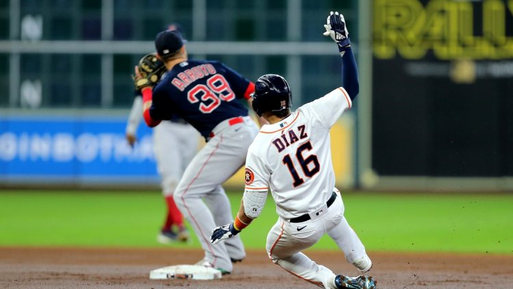 Jun 3, 2021; Houston, Texas, USA; Houston Astros shortstop Aledmys Diaz (16) slides into second base after hitting a double to left field against the Boston Red Sox during the first inning at Minute Maid Park. Mandatory Credit: Erik Williams-USA TODAY Sports