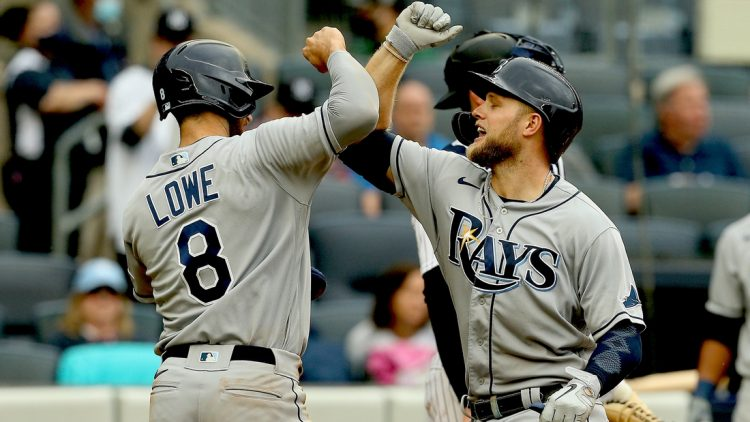 Jun 3, 2021; Bronx, New York, USA; Tampa Bay Rays designated hitter Austin Meadows (17) is congratulated by  second baseman Brandon Lowe (8) after hitting a two run home run against the New York Yankees during the fourth inning at Yankee Stadium. Mandatory Credit: Andy Marlin-USA TODAY Sports