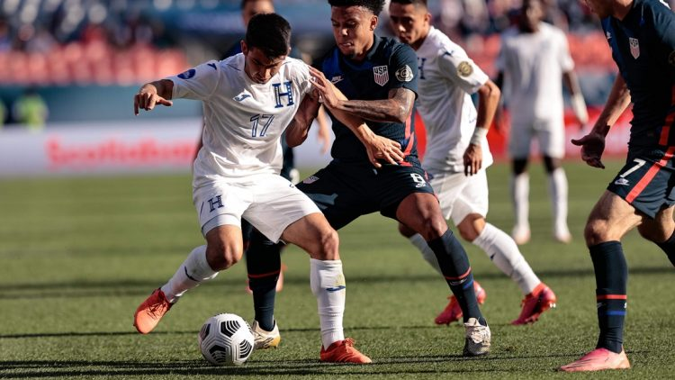 Jun 3, 2021; Denver, Colorado, USA; Honduras midfielder Jonathan Rubio (17) and United States midfielder Weston Mckennie (8) battle for the ball in the first half during the semifinals of the 2021 CONCACAF Nations League soccer series at Empower Field at Mile High. Mandatory Credit: Isaiah J. Downing-USA TODAY Sports