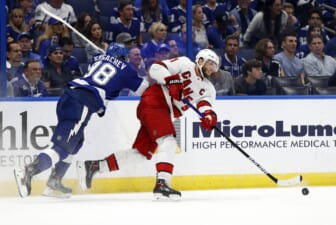 Jun 3, 2021; Tampa, Florida, USA; Carolina Hurricanes center Jordan Staal (11) passes the puck as Tampa Bay Lightning defenseman Mikhail Sergachev (98) defends during the second period in game three of the second round of the 2021 Stanley Cup Playoffs at Amalie Arena. Mandatory Credit: Kim Klement-USA TODAY Sports