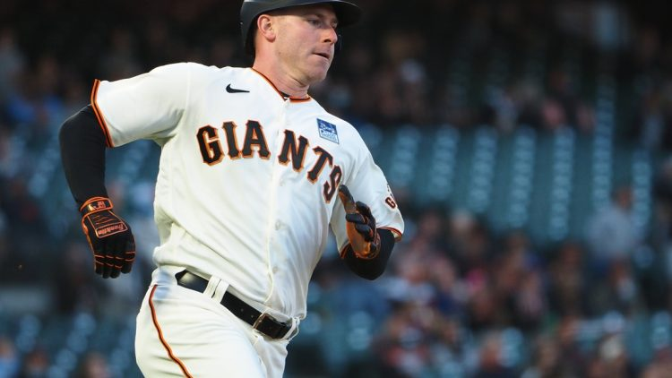 Jun 3, 2021; San Francisco, California, USA; San Francisco Giants starting pitcher Anthony DeSclafani (26) rounds first base for an RBI double against the Chicago Cubs during the fourth inning at Oracle Park. Mandatory Credit: Kelley L Cox-USA TODAY Sports