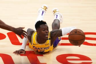 Jun 3, 2021; Los Angeles, California, USA; Los Angeles Lakers guard Dennis Schroder (17) reaches for the ball against the Phoenix Suns in the second half during game six in the first round of the 2021 NBA Playoffs at Staples Center. Mandatory Credit: Kirby Lee-USA TODAY Sports