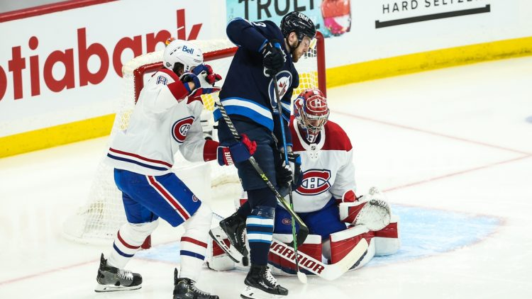 Jun 4, 2021; Winnipeg, Manitoba, CAN; Winnipeg Jets forward Pierre-Luc Dubois (13) tries to deflect the puck past Montreal Canadiens goalie Carey Price (31) during the first period in game two of the second round of the 2021 Stanley Cup Playoffs at Bell MTS Place. Mandatory Credit: Terrence Lee-USA TODAY Sports