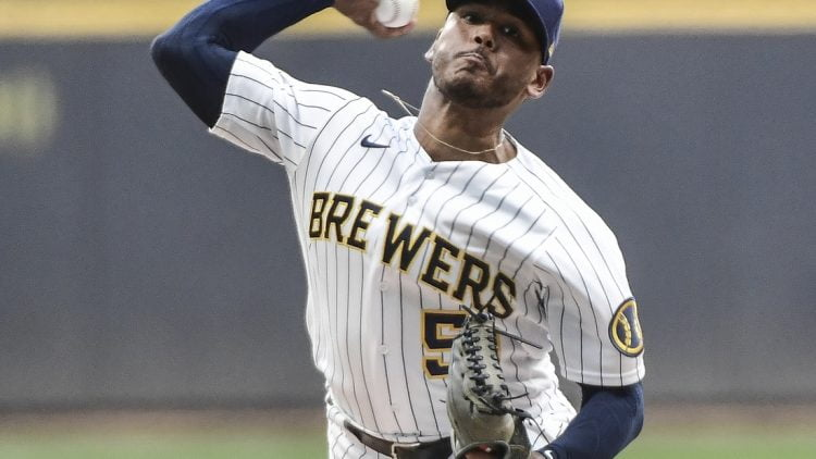 Jun 4, 2021; Milwaukee, Wisconsin, USA;  Milwaukee Brewers pitcher Freddy Peralta (51) pitches in the first inning against the Arizona Diamondbacks at American Family Field. Mandatory Credit: Benny Sieu-USA TODAY Sports