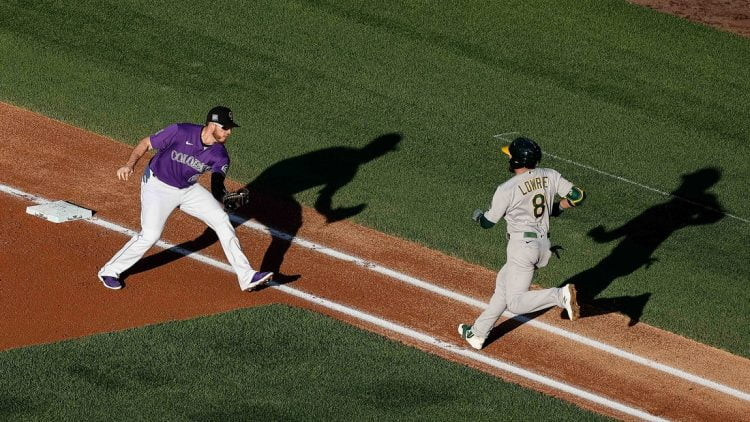 Jun 4, 2021; Denver, Colorado, USA; Oakland Athletics second baseman Jed Lowrie (8) runs towards the tag from Colorado Rockies first baseman C.J. Cron (25) in the first inning at Coors Field. Mandatory Credit: Isaiah J. Downing-USA TODAY Sports