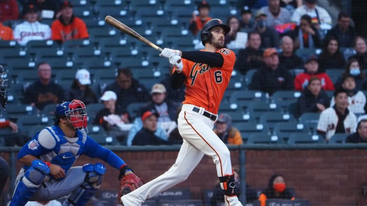 Jun 4, 2021; San Francisco, California, USA; San Francisco Giants center fielder Steven Duggar (6) hits a two-run home run ahead of Chicago Cubs catcher Willson Contreras (40) during the second inning at Oracle Park. Mandatory Credit: Kelley L Cox-USA TODAY Sports