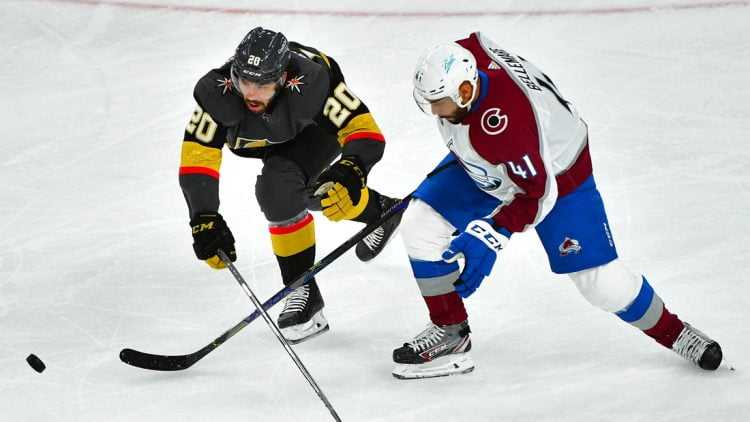 Jun 4, 2021; Las Vegas, Nevada, USA; Colorado Avalanche center Pierre-Edouard Bellemare (41) tips the puck off the stick of Vegas Golden Knights center Chandler Stephenson (20) during the first period of game three of the second round of the 2021 Stanley Cup Playoffs at T-Mobile Arena. Mandatory Credit: Stephen R. Sylvanie-USA TODAY Sports