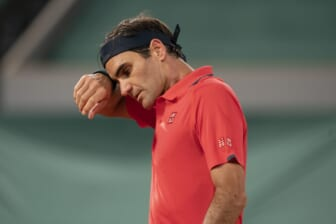 Jun 5, 2021; Paris, France; Roger Federer (SUI) wipes his brow during his match against Dominik Koepfer (GER) on day seven of the French Open at Stade Roland Garros. Mandatory Credit: Susan Mullane-USA TODAY Sports
