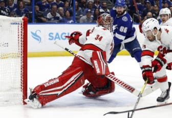 Jun 5, 2021; Tampa, Florida, USA; Carolina Hurricanes goaltender Petr Mrazek (34) makes a save against the Tampa Bay Lightning during the first period in game four of the second round of the 2021 Stanley Cup Playoffs at Amalie Arena. Mandatory Credit: Kim Klement-USA TODAY Sports