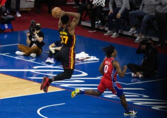 Jun 6, 2021; Philadelphia, Pennsylvania, USA; Atlanta Hawks forward Onyeka Okongwu (17) drives for a dunk past Philadelphia 76ers guard Tyrese Maxey (0) during the second quarter of game one in the second round of the 2021 NBA Playoffs at Wells Fargo Center. Mandatory Credit: Bill Streicher-USA TODAY Sports
