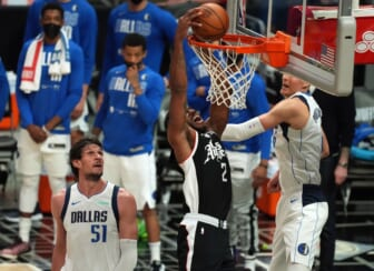 Jun 6, 2021; Los Angeles, California, USA; Los Angeles Clippers forward Kawhi Leonard (2) moves in for a basket against Dallas Mavericks center Kristaps Porzingis (6) and center Boban Marjanovic (51) during the second half in game seven of the first round of the 2021 NBA Playoffs. at Staples Center. Mandatory Credit: Kirby Lee-USA TODAY Sports