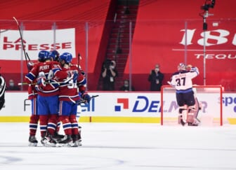 Jun 6, 2021; Montreal, Quebec, CAN; Montreal Canadiens forward Corey Perry (94) reacts with teammates after scoring a goal against Winnipeg Jets goalie Connor Hellebuyck (37) during the first period in game three of the second round of the 2021 Stanley Cup Playoffs at the Bell Centre. Mandatory Credit: Eric Bolte-USA TODAY Sports