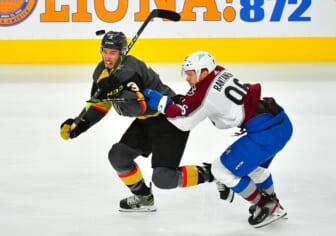 Jun 6, 2021; Las Vegas, Nevada, USA; Vegas Golden Knights defenseman Brayden McNabb (3) eyes the puck while taking a check from Colorado Avalanche right wing Mikko Rantanen (96) during the first period of game four of the second round of the 2021 Stanley Cup Playoffs at T-Mobile Arena. Mandatory Credit: Stephen R. Sylvanie-USA TODAY Sports