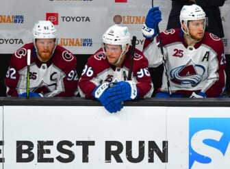 Jun 6, 2021; Las Vegas, Nevada, USA; Colorado Avalanche left wing Gabriel Landeskog (92), Colorado Avalanche right wing Mikko Rantanen (96), and Colorado Avalanche center Nathan MacKinnon (29) are pictured on the bench late in the third period of game four of the second round of the 2021 Stanley Cup Playoffs against the Vegas Golden Knights at T-Mobile Arena. Mandatory Credit: Stephen R. Sylvanie-USA TODAY Sports