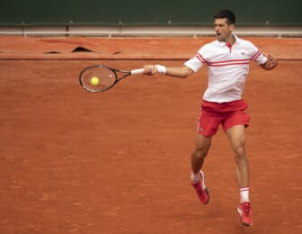 Jun 7, 2021; Paris, France; Novak Djokovic (SRB) in action during his match against Lorenzo Musetti (ITA) on day nine of the French Open at Stade Roland Garros. Mandatory Credit: Susan Mullane-USA TODAY Sports