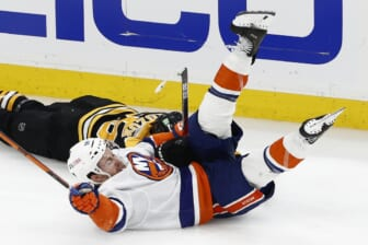 Jun 7, 2021; Boston, Massachusetts, USA; New York Islanders left wing Anthony Beauvillier (18) goes down after colliding with Boston Bruins defenseman Jeremy Lauzon (55) during the third period of game five of the second round of the 2021 Stanley Cup Playoffs at TD Garden. Mandatory Credit: Winslow Townson-USA TODAY Sports