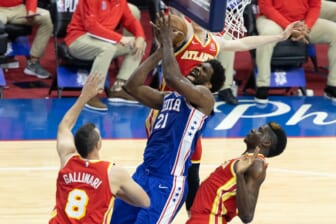 Jun 8, 2021; Philadelphia, Pennsylvania, USA; Philadelphia 76ers center Joel Embiid (21) drives for a shot against Atlanta Hawks center Clint Capela (15) and forward Danilo Gallinari (8) during the first quarter in game two of the second round of the 2021 NBA Playoffs at Wells Fargo Center. Mandatory Credit: Bill Streicher-USA TODAY Sports