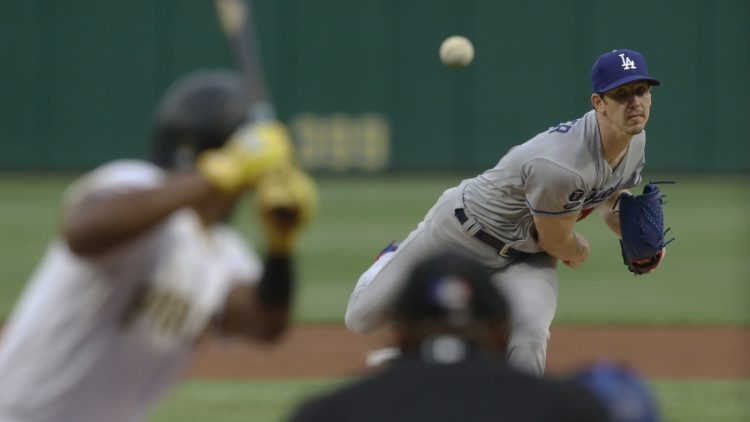 Jun 8, 2021; Pittsburgh, Pennsylvania, USA;  Los Angeles Dodgers starting pitcher Walker Buehler (21) pithes to Pittsburgh Pirates third baseman Ke'Bryan Hayes (13) during the first inning at PNC Park. Mandatory Credit: Charles LeClaire-USA TODAY Sports