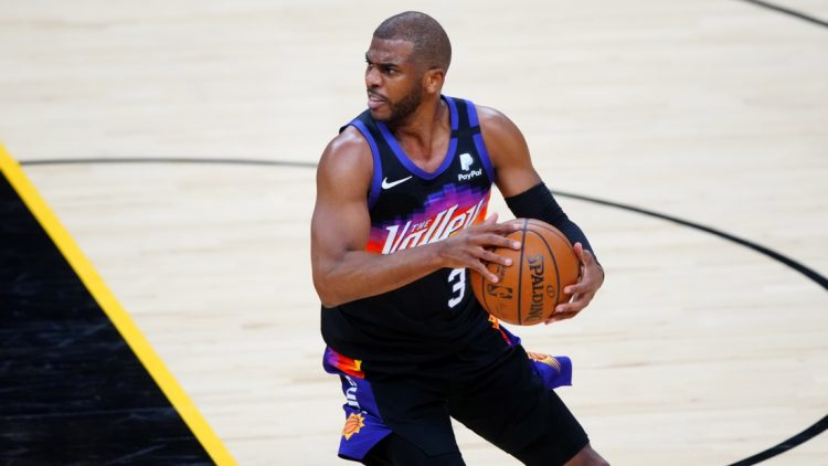 Jun 7, 2021; Phoenix, Arizona, USA; Phoenix Suns guard Chris Paul (3) against the Denver Nuggets during game one in the second round of the 2021 NBA Playoffs at Phoenix Suns Arena. Mandatory Credit: Mark J. Rebilas-USA TODAY Sports