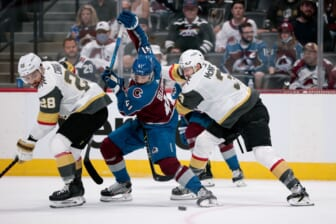 Jun 8, 2021; Denver, Colorado, USA; Colorado Avalanche center Pierre-Edouard Bellemare (41) battles for control of the puck with Vegas Golden Knights defenseman Peter DiLiberatore (3) and left wing William Carrier (28) in the first period in game five of the second round of the 2021 Stanley Cup Playoffs at Ball Arena. Mandatory Credit: Isaiah J. Downing-USA TODAY Sports