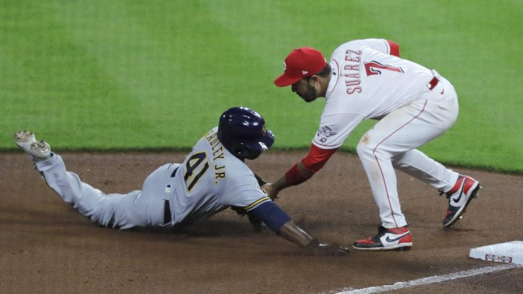 Jun 8, 2021; Cincinnati, Ohio, USA; Milwaukee Brewers center fielder Jackie Bradley Jr. (41) is tagged out at third by Cincinnati Reds third baseman Eugenio Suarez (7) during the seventh inning at Great American Ball Park. Mandatory Credit: David Kohl-USA TODAY Sports