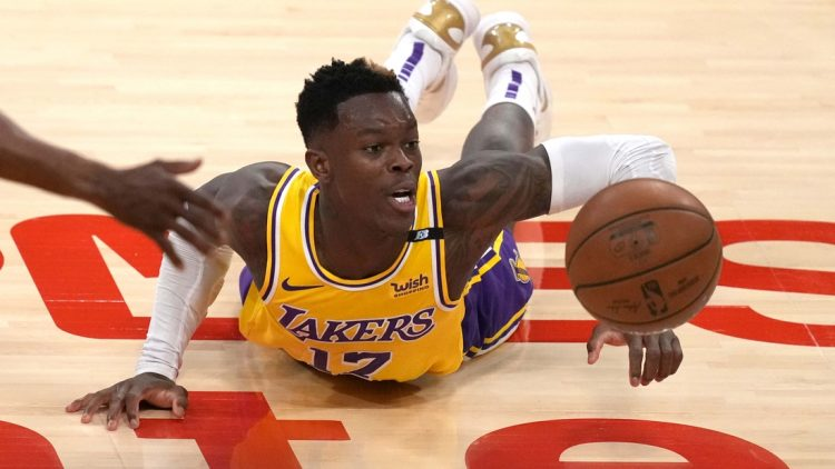 Jun 3, 2021; Los Angeles, California, USA; Los Angeles Lakers guard Dennis Schroder (17) reaches for the ball against the Phoenix Suns in the second half during game six in the first round of the 2021 NBA Playoffs. at Staples Center. Mandatory Credit: Kirby Lee-USA TODAY Sports