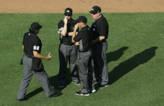Jun 5, 2021; Pittsburgh, Pennsylvania, USA;  Home plate umpire James Hoye (92) talks with fellow umpires Sean Barber (29) and Cory Blaser (middle) and Brian Gorman (right) during the game between the Miami Marlins and the Pittsburgh Pirates in the fourth inning at PNC Park. Mandatory Credit: Charles LeClaire-USA TODAY Sports