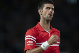 Jun 9, 2021; Paris, France; Novak Djokovic (SRB) reacts during his match against Matteo Berrettini (ITA) on day 11 of the French Open at Stade Roland Garros. Mandatory Credit: Susan Mullane-USA TODAY Sports