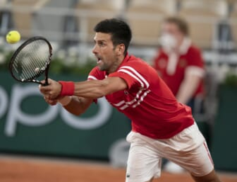 Jun 9, 2021; Paris, France; Novak Djokovic (SRB) in action during his match against Matteo Berrettini (ITA) on day 11 of the French Open at Stade Roland Garros. Mandatory Credit: Susan Mullane-USA TODAY Sports