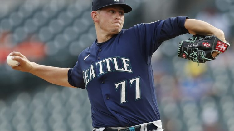Jun 9, 2021; Detroit, Michigan, USA; Seattle Mariners starting pitcher Chris Flexen (77) throws a pitch during the first inning against the Detroit Tigers at Comerica Park. Mandatory Credit: Raj Mehta-USA TODAY Sports