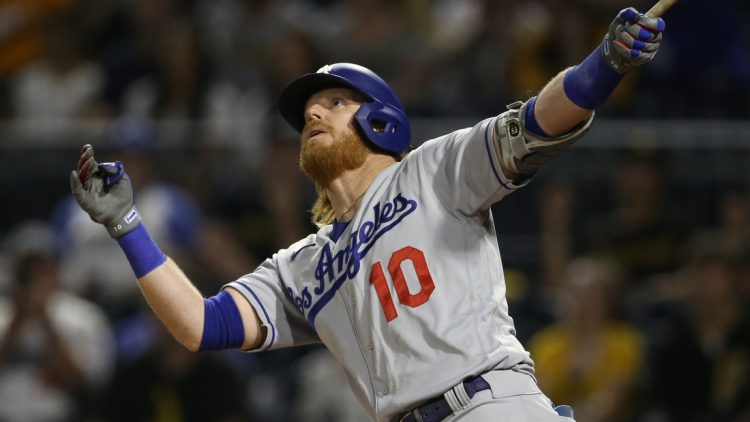 Jun 9, 2021; Pittsburgh, Pennsylvania, USA;  Los Angeles Dodgers third baseman Justin Turner (10) watches his second solo home run of the game clear the fence against the Pittsburgh Pirates during the third inning at PNC Park. Mandatory Credit: Charles LeClaire-USA TODAY Sports