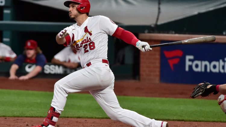 Jun 9, 2021; St. Louis, Missouri, USA;  St. Louis Cardinals third baseman Nolan Arenado (28) hits a double during the third inning against the Cleveland Indians at Busch Stadium. Mandatory Credit: Jeff Curry-USA TODAY Sports