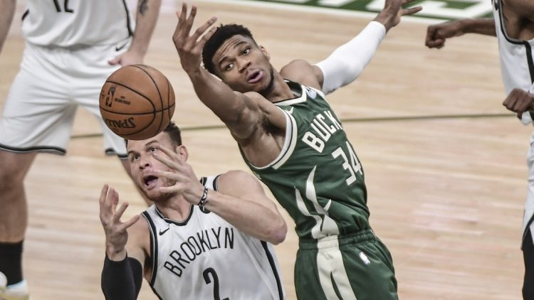 Jun 10, 2021; Milwaukee, Wisconsin, USA; Milwaukee Bucks forward Giannis Antetokounmpo (34) and Brooklyn Nets forward Blake Griffin (2) reach for a rebound in the first quarter during game three in the second round of the 2021 NBA Playoffs at Fiserv Forum. Mandatory Credit: Benny Sieu-USA TODAY Sports