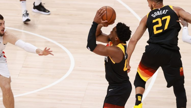 Jun 10, 2021; Salt Lake City, Utah, USA; Utah Jazz guard Donovan Mitchell (45) shoots a three-point shot during the first quarter against the LA Clippers during game two of the second round of the 2021 NBA Playoffs at Vivint Arena. Mandatory Credit: Chris Nicoll-USA TODAY Sports