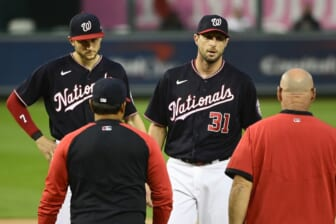 Jun 11, 2021; Washington, District of Columbia, USA;  Washington Nationals starting pitcher Max Scherzer (31) stands on the pitcher's mound as manager Dave Martinez (4) and the team trainer approach during the first inning against the San Francisco Giants at Nationals Park. Mandatory Credit: Tommy Gilligan-USA TODAY Sports