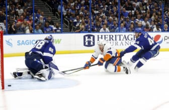 Jun 13, 2021; Tampa, Florida, USA; New York Islanders center Mathew Barzal (13) scores a goal on Tampa Bay Lightning goaltender Andrei Vasilevskiy (88) as defenseman Jan Rutta (44) attempted to defend during the second period in game one of the 2021 Stanley Cup Semifinals at Amalie Arena. Mandatory Credit: Kim Klement-USA TODAY Sports