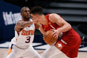 Jun 13, 2021; Denver, Colorado, USA; Denver Nuggets forward Michael Porter Jr. (1) controls the ball as Phoenix Suns guard Chris Paul (3) defends in the second quarter during game four in the second round of the 2021 NBA Playoffs at Ball Arena. Mandatory Credit: Isaiah J. Downing-USA TODAY Sports