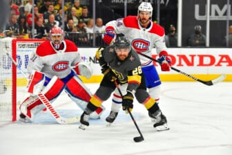 Jun 14, 2021; Las Vegas, Nevada, USA; Montreal Canadiens defenseman Joel Edmundson (44) checks Vegas Golden Knights left wing William Carrier (28) as Montreal Canadiens goaltender Carey Price (31) defends his goal during the first period of game one of the 2021 Stanley Cup Semifinals at T-Mobile Arena. Mandatory Credit: Stephen R. Sylvanie-USA TODAY Sports